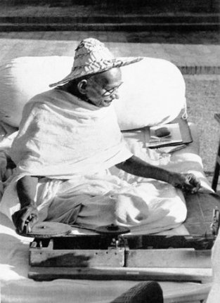Gandhi Spinning in Naokhali. Image source: Wikimedia
